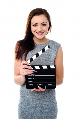 Woman with clapper board