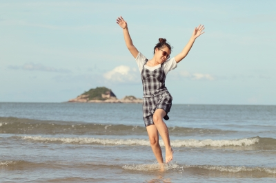 Woman free on beach