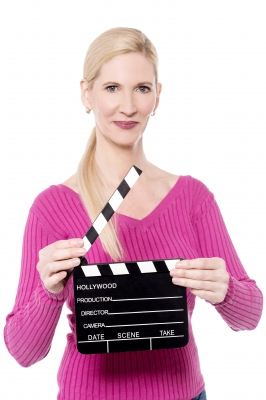 Woman holding clapper board