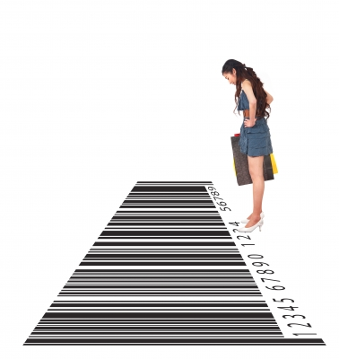 Woman looking at large bar code