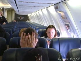 man scared on plane